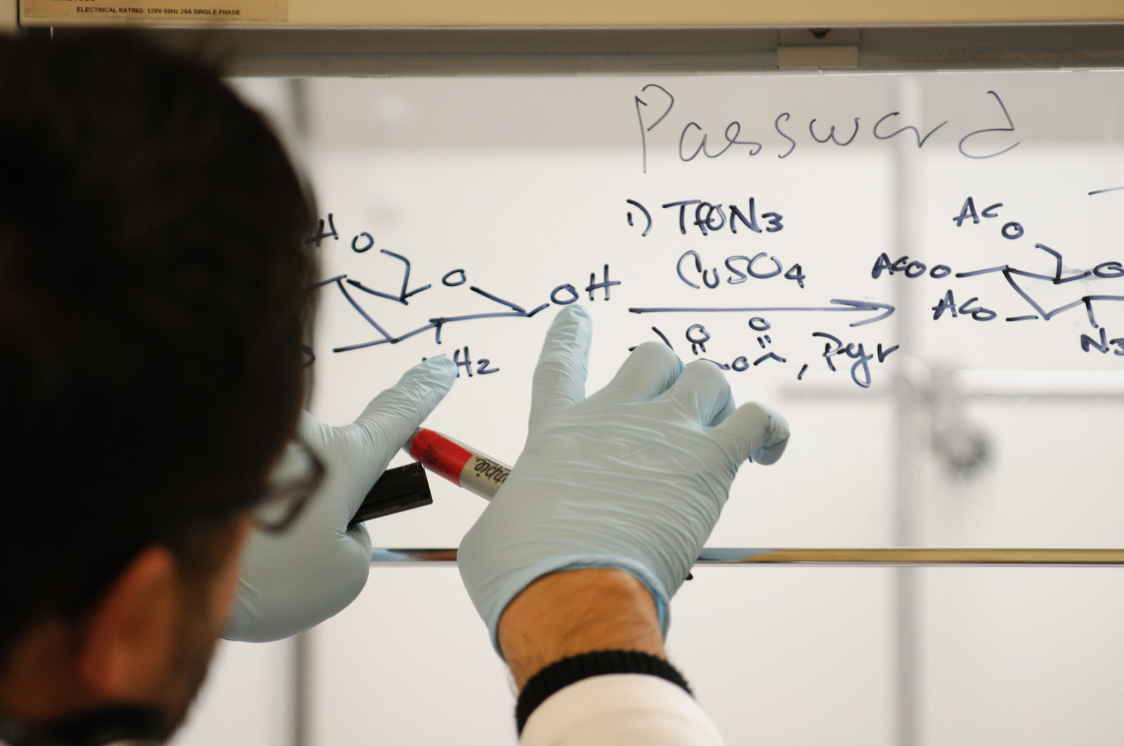 Chemical compounds written on a whiteboard